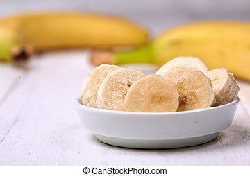 Sliced banana on white table
