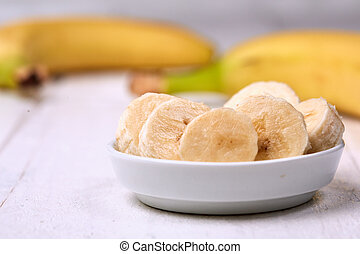Sliced banana on white table