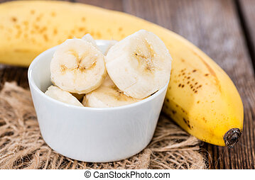 Sliced Banana - Banana Slices in a small bowl (on vintage...