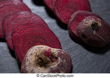 Sliced beetroots arranged on white background