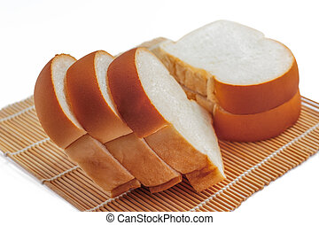 Sliced bread on a bamboo mat.