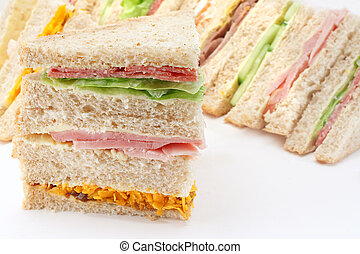 Selection of Sandwiches in front of a platter of various fillings at buffet