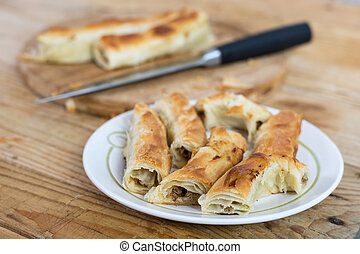 Sliced burek with meat on the plate