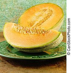Sliced Cantaloupe on a Wooden Table - Sliced Cantaloupe on a...