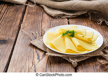 Sliced Cheese on wooden background - Sliced Cheese on rustic...