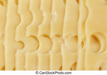 sliced cheese with big holes