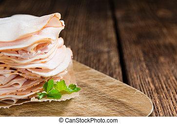 Sliced Chicken Breast fillet (selective focus) on wooden...