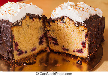 Sliced christmas fruit cake with frosting and nuts