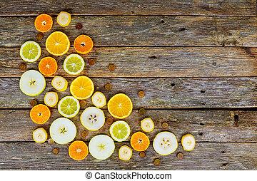 Sliced citrus fruits, oranges, limes, juicy fruits background
