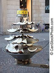 Sliced coconut inside a fountain