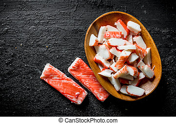 Sliced crab sticks on a plate.