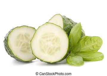 Sliced cucumber vegetable and basil leaves still life