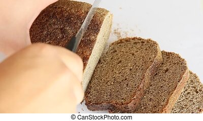sliced dark bread pieces, on white