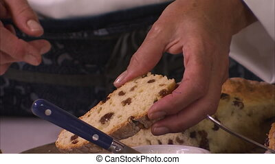 Sliced delicious raisin bread - A close up tracking shot of...