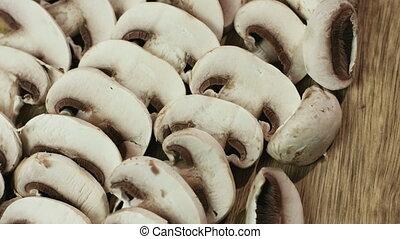 Sliced edible mushrooms known as Agaricus. - Sliced edible...
