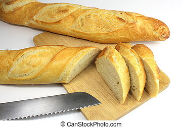 Sliced fresh baguette and bread kni