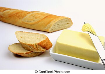 Sliced fresh baguette and butter