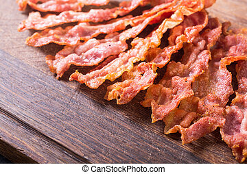 Sliced fried bacon