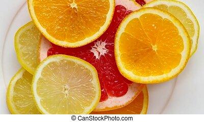 Sliced grapefruit, orange and lemon