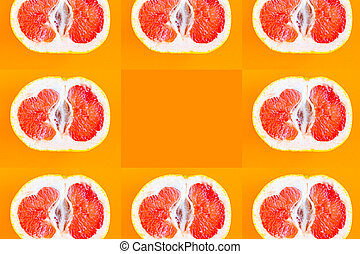 Sliced grapefruit pattern on bright orange background, minimal concept, copy space