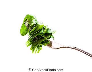 sliced  green fresh spinach on vintage fork