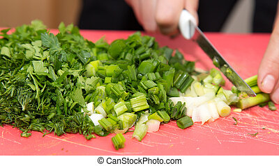 sliced green onions with a knife