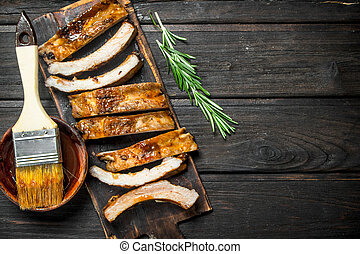 Sliced grilled ribs with sauce.
