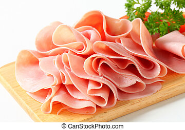 Sliced ham - Thinly sliced ham on cutting board