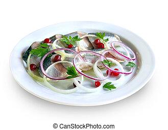 Sliced herring on a plate