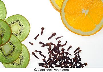 sliced kiwi fruit and orange with clove
