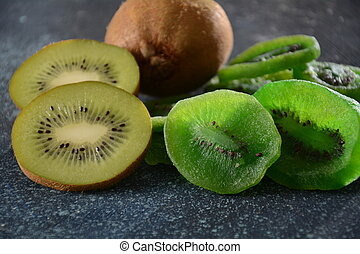 Sliced kiwi fruit  in pieces  fresh and dried