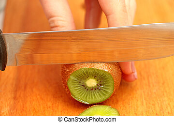 sliced kiwi fruit on a tree in circles until the end