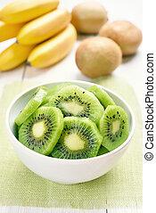 Sliced kiwi in white bowl