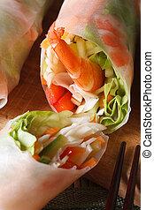Korean spring rolls with shrimp and vegetables macro. vertical.