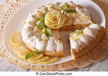 sliced lemon meringue pie close-up on the table. horizontal