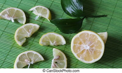 sliced lemon on a green background