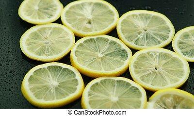 Sliced lemon on table - Closeup circle slices of fresh lemon...