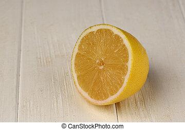 Sliced lemon on the table. Close up. White background