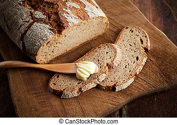 Sliced loaf of freshly baked rye bread