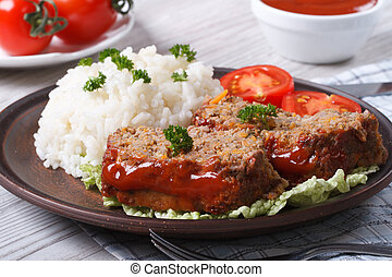 sliced meat loaf with rice and vegetables, horizontal