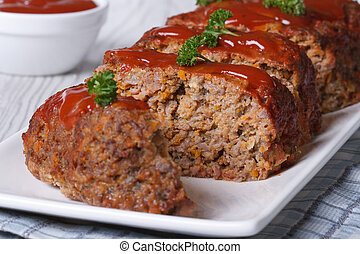 sliced meatloaf with ketchup and parsley horizontal - sliced...