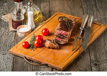 Sliced medium rare grilled Beef steak Ribeye