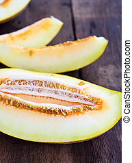 Sliced melon on a brown wooden table