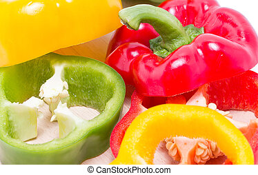 Sliced of colorful sweet peppers.