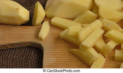 Sliced old potatoes on a cutting board