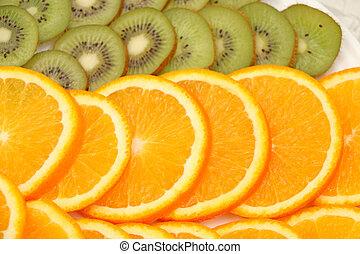 sliced orange in the background exposed kiwi
