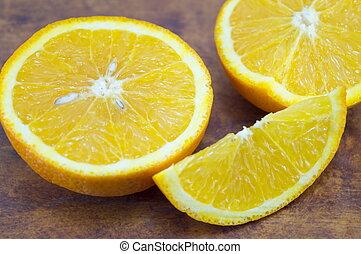 Sliced orange on a wooden table