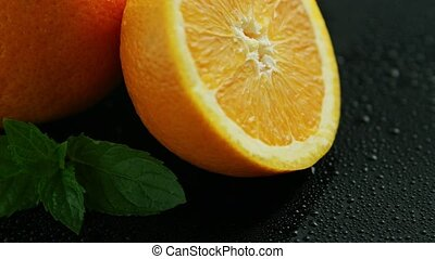 Sliced orange with green leaves - Closeup sliced orange with...
