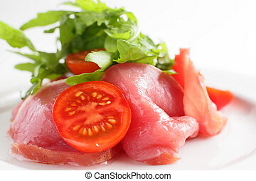 sliced peaces of meat with tomato