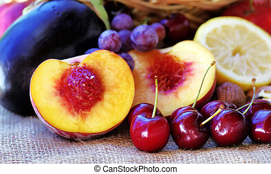 Sliced peach, berries and other fruits